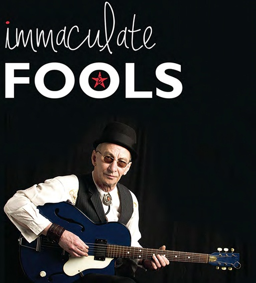 immaculate fools advert showing kevin weatherill with a blue guitar
